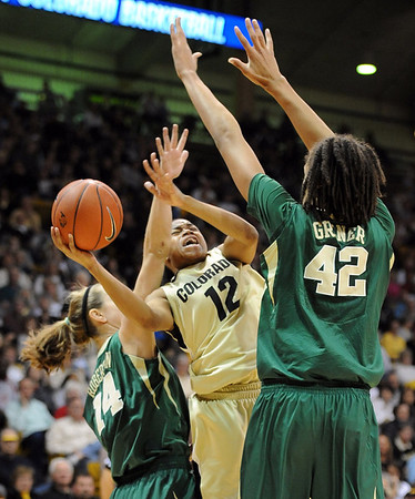 "Ashley Wilson of CU, puts up a shot on Brittney Griner of Baylor.<br /> For more photos of the game, go to  <a href=""http://www.dailycamera.com"">http://www.dailycamera.com</a>.<br /> Cliff Grassmick / March 5, 2011"