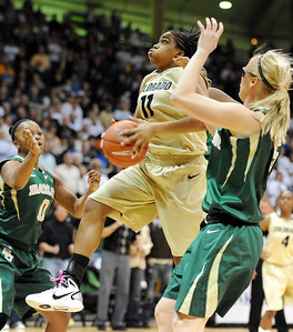 Brittany Wilson of CU gets around Odyssey Sims, left, and Melissa Jones of Baylor. For more photos of the game, go to www.dailycamera.com. Cliff Grassmick / March 5, 2011