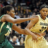 "Brittany Spears of Colorado drives around Destiny Williams of Baylor.<br /> For more photos of the game, go to  <a href=""http://www.dailycamera.com"">http://www.dailycamera.com</a>.<br /> Cliff Grassmick / March 5, 2011"