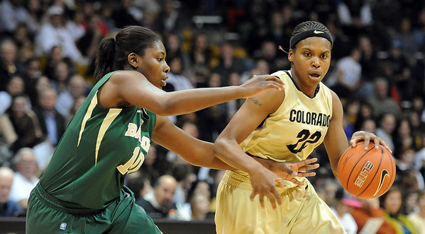 Brittany Spears of Colorado drives around Destiny Williams of Baylor. For more photos of the game, go to www.dailycamera.com. Cliff Grassmick / March 5, 2011