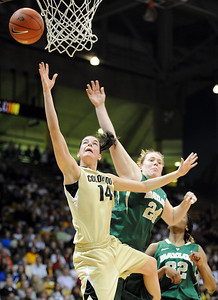 Meagan Malcolm-Peck of CU gets past Ashley Field of Baylor. For more photos of the game, go to www.dailycamera.com. Cliff Grassmick / March 5, 2011