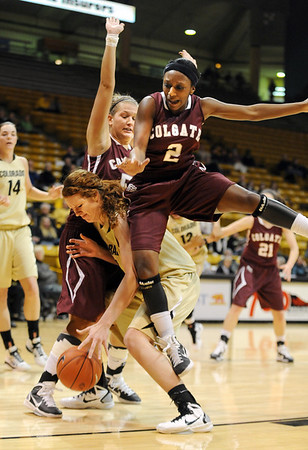 "Jhazmine Lynch (2) of Colgate lands on Rachel Hargis of CU after a ball fake.<br /> For more photos of the game, go to  <a href=""http://www.dailycamera.com"">http://www.dailycamera.com</a>.<br /> Cliff Grassmick / December 30, 2010"