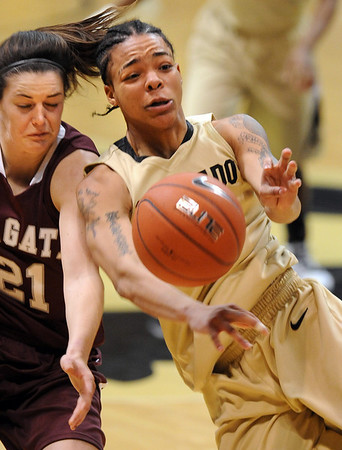 """Chucky Jeffery, right, of CU, out muscles Sami Kozlowski of Colgate.<br /> For more photos of the game, go to  <a href=""""http://www.dailycamera.com"""">http://www.dailycamera.com</a>.<br /> Cliff Grassmick / December 30, 2010"""