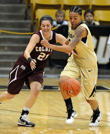 """Chucky Jeffery, right, of CU, steals the ball from Sami Kozlowski of Colgate.<br /> For more photos of the game, go to  <a href=""""http://www.dailycamera.com"""">http://www.dailycamera.com</a>.<br /> Cliff Grassmick / December 30, 2010"""