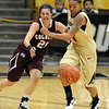 "Chucky Jeffery, right, of CU, steals the ball from Sami Kozlowski of Colgate.<br /> For more photos of the game, go to  <a href=""http://www.dailycamera.com"">http://www.dailycamera.com</a>.<br /> Cliff Grassmick / December 30, 2010"