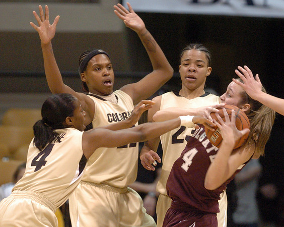 "Britney Blythe, left, Brittany Spears and Chucky Jeffery, all of CU, pressure Tayler Wejnert of Colgate.<br /> For more photos of the game, go to  <a href=""http://www.dailycamera.com"">http://www.dailycamera.com</a>.<br /> Cliff Grassmick / December 30, 2010"