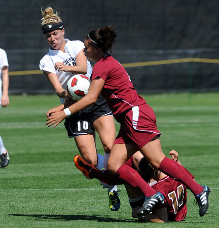 """Amy Barczuk, left, of CU, and Nicholette DiGiacomo of DU, collide going for the ball.<br /> For more photos of the game, go to  <a href=""""http://www.dailycamera.com"""">http://www.dailycamera.com</a>.<br /> Cliff Grassmick / September 11, 2011"""