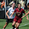 "Kate Russell, left, of CU, and Stephanie Woo of DU, make eye contact with the ball on Sunday.<br /> For more photos of the game, go to  <a href=""http://www.dailycamera.com"">http://www.dailycamera.com</a>.<br /> Cliff Grassmick / September 11, 2011"