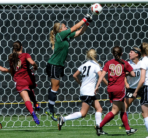 "Colorado goal keeper, Annie Brunner, punches out a shot by Denver University.<br /> For more photos of the game, go to  <a href=""http://www.dailycamera.com"">http://www.dailycamera.com</a>.<br /> Cliff Grassmick / September 11, 2011"