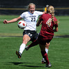 "Anne Stuller, left, of CU, tries to block the kick of Sam Harder of DU on Sunday.<br /> For more photos of the game, go to  <a href=""http://www.dailycamera.com"">http://www.dailycamera.com</a>.<br /> Cliff Grassmick / September 11, 2011"