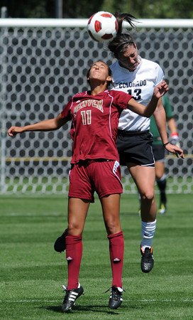 "Kalie Vaughn, left, of DU, and Kate Russell of CU, get in the air to make contact.<br /> For more photos of the game, go to  <a href=""http://www.dailycamera.com"">http://www.dailycamera.com</a>.<br /> Cliff Grassmick / September 11, 2011"