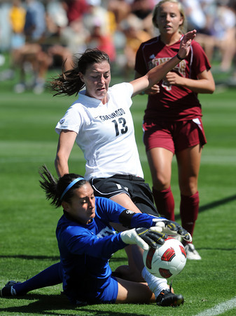 """Kate Russell (13) of CU, tries to get to the loose ball before the DU keeper, Lara Campbell does.<br /> For more photos of the game, go to  <a href=""""http://www.dailycamera.com"""">http://www.dailycamera.com</a>.<br /> Cliff Grassmick / September 11, 2011"""