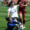 "Kate Russell (13) of CU, tries to get to the loose ball before the DU keeper, Lara Campbell does.<br /> For more photos of the game, go to  <a href=""http://www.dailycamera.com"">http://www.dailycamera.com</a>.<br /> Cliff Grassmick / September 11, 2011"