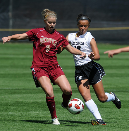 "Kaitlin Bast, left, of DU, and Bianca Jones of CU, chase down a ball on Sunday.<br /> For more photos of the game, go to  <a href=""http://www.dailycamera.com"">http://www.dailycamera.com</a>.<br /> Cliff Grassmick / September 11, 2011"