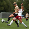 Amy Barczuk, left, of CU, tries to control the ball from Lizzy Carlson of DU on Friday.<br /> Cliff Grassmick / September 4, 2009