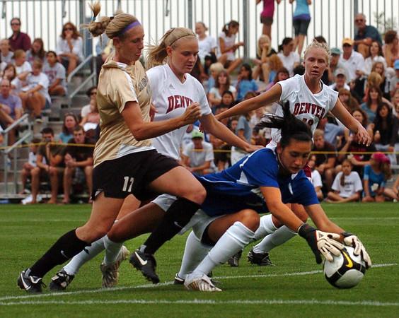 Nikki Marshall (17) of CU attacks the  the DU goal. <br /> Cliff Grassmick / September 4, 2009