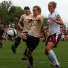 Ally Goodman, left, of CU, gets her foot on the ball in front of Emily Stewart of DU.<br /> Cliff Grassmick / September 4, 2009