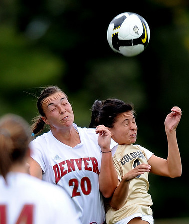 Mariah Johnston, left, of DU, and Quinn Krier  of CU, both try to get their head on the ball on Friday.<br /> Cliff Grassmick / September 4, 2009