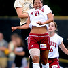 Amy Barczuk, left, of CU,out jumps Lizzy Carlson of DU, on a header.<br /> Cliff Grassmick / September 4, 2009