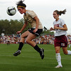 Kelly Menachof, left, of CU, gets to the ball before Katy Van Lieshout of DU on Friday.<br /> Cliff Grassmick / September 4, 2009