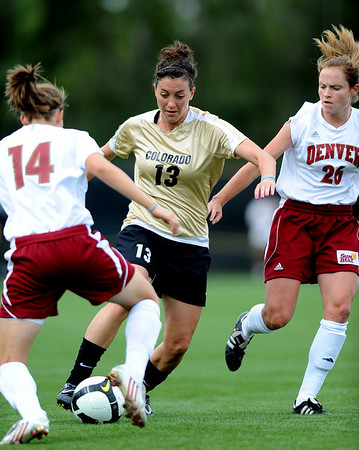 Kate Russell of Colorado splits the Denver defenders on Friday.<br /> Cliff Grassmick / September 4, 2009