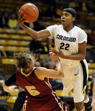 Brittany Spears  of CU flips up a shot on Britteni Rice of DU.<br /> <br /> Cliff Grassmick / December 2, 2009