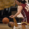 Chucky Jeffery, bottom, of CU and Emiko Smith of Denver, battle for the ball on Wednesday.<br /> <br /> Cliff Grassmick / December 2, 2009