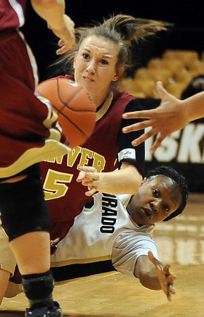 Britteni Rice, top, of Denver, and Whitney Houston battle on the floor Wednesday.<br /> <br /> Cliff Grassmick / December 2, 2009