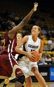 Julie Seabrook of Colorado goes up on Ashley Robinson  of DU on Wednesday.  Cliff Grassmick / December 2, 2009