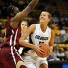 Julie Seabrook of Colorado goes up on Ashley Robinson  of DU on Wednesday.<br /> <br /> Cliff Grassmick / December 2, 2009