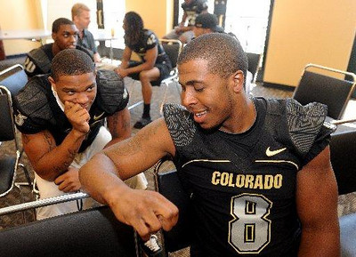 Jimmy Smith, left, and Demetrius Sumler talk on CU football media day on Saturday (Photo by Cliff Grassmick).