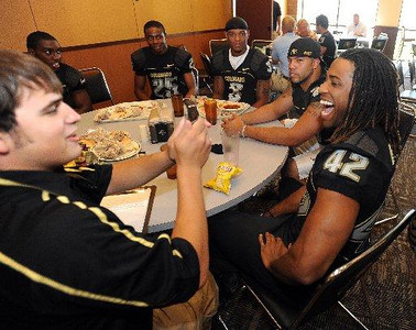 Ben Burney, right, answers questions during CU media day on Saturday (Photo by Cliff Grassmick).