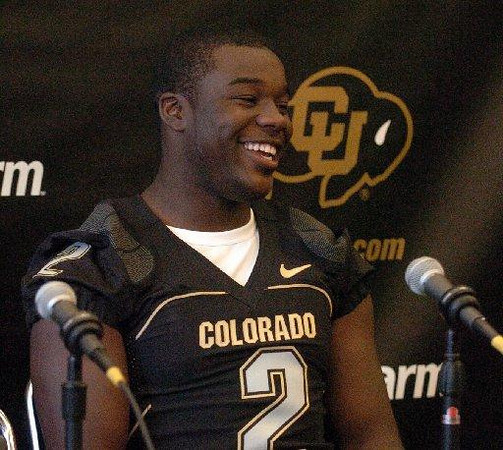Darrell Scott talks to the media on CU football media day on Saturday (Photo by Cliff Grassmick).