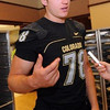 Nate Solder talks to the press on CU football media day on Saturday (Photo by Cliff Grassmick).