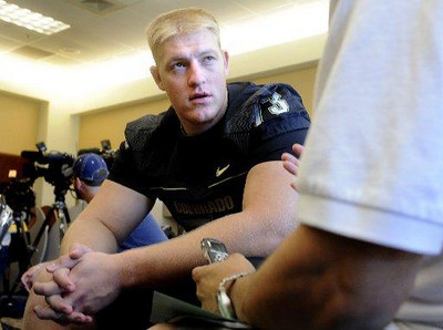 University of Colorado offensive gaurd Ryan Miller talks with a reporter at the Media Day on Saturday, Aug. 8, 2009 (Photo by Mara Auster).