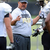 "CU assistant, Mike Tuiososopo, works with defensive linemen on Wednesday.<br /> For photos of today's practice, go to  <a href=""http://www.dailycamera.com"">http://www.dailycamera.com</a><br /> Cliff Grassmick / August 24, 2011"
