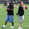 "Former Buff and Bronco, Mike Pritchard, talks with Greg Brown during Wednesday's practice.<br /> For photos of today's practice, go to  <a href=""http://www.dailycamera.com"">http://www.dailycamera.com</a><br /> Cliff Grassmick / August 24, 2011"