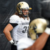 """Linebacker,  Jon Major, works during drills on Wednesday.<br /> For photos of today's practice, go to  <a href=""""http://www.dailycamera.com"""">http://www.dailycamera.com</a><br /> Cliff Grassmick / August 24, 2011"""