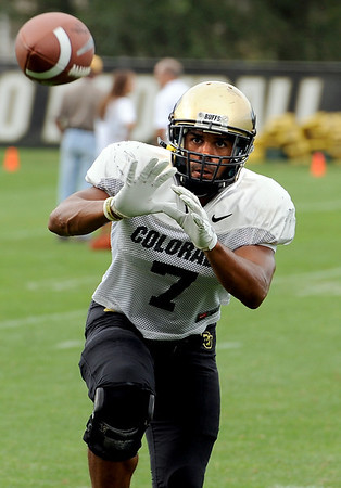 "DB Anthony Perkins catches a pass during drills on Wednesday.<br /> For photos of today's practice, go to  <a href=""http://www.dailycamera.com"">http://www.dailycamera.com</a><br /> Cliff Grassmick / August 24, 2011"