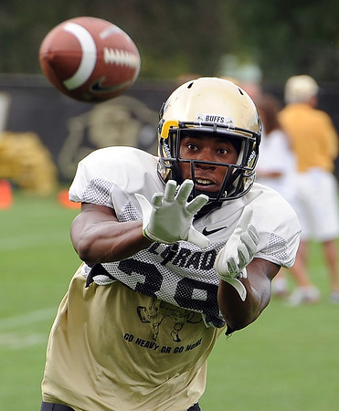 "DB Josh Moten catches a pass during drills on Wednesday.<br /> For photos of today's practice, go to  <a href=""http://www.dailycamera.com"">http://www.dailycamera.com</a><br /> Cliff Grassmick / August 24, 2011"