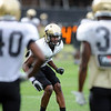 """DB Ayodeji Olatoye works during drills on Wednesday.<br /> For photos of today's practice, go to  <a href=""""http://www.dailycamera.com"""">http://www.dailycamera.com</a><br /> Cliff Grassmick / August 24, 2011"""