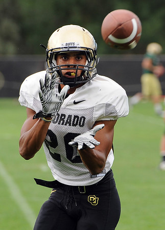 "DB Greg Henderson catches a pass during drills on Wednesday.<br /> For photos of today's practice, go to  <a href=""http://www.dailycamera.com"">http://www.dailycamera.com</a><br /> Cliff Grassmick / August 24, 2011"