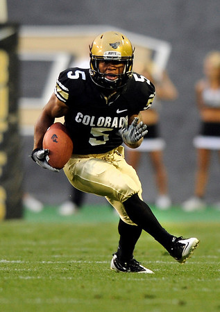 "University of Colorado tailback Rodney Stewart rushes the ball during the football game against University of Georgia on Saturday, Oct. 2, at Folsom Field. For more photos go to  <a href=""http://www.dailycamera.com"">http://www.dailycamera.com</a><br /> Photo by Jeremy Papasso"