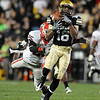 """Will Jefferson of CU makes a hug catch over Vance Cuff of UGA.<br /> For more photos from the game go to  <a href=""""http://www.dailycamera.com"""">http://www.dailycamera.com</a>.<br /> Cliff Grassmick / October 2, 2010"""
