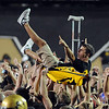 """CU fans celebrate the win over Georgia.<br /> For more photos from the game go to  <a href=""""http://www.dailycamera.com"""">http://www.dailycamera.com</a>.<br /> Cliff Grassmick / October 2, 2010"""