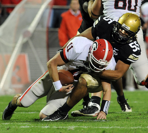 "Josh Hartigan of CU sacks Aaron Murray of Georgia.<br /> For more photos from the game go to  <a href=""http://www.dailycamera.com"">http://www.dailycamera.com</a>.<br /> Cliff Grassmick / October 2, 2010"