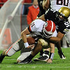 """Josh Hartigan of CU sacks Aaron Murray of Georgia.<br /> For more photos from the game go to  <a href=""""http://www.dailycamera.com"""">http://www.dailycamera.com</a>.<br /> Cliff Grassmick / October 2, 2010"""
