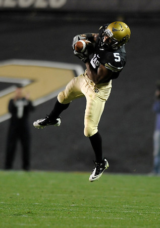 "University of Colorado tailback Rodney Stewart makes a leaping catch during the football game against University of Georgia on Saturday, Oct. 2, at Folsom Field. The Buffs defeated Georgia 29-27.  For more photos go to  <a href=""http://www.dailycamera.com"">http://www.dailycamera.com</a><br /> Photo by Jeremy Papasso"