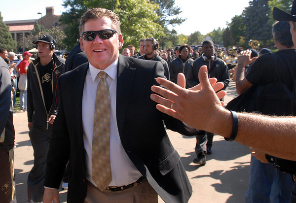 """Coach Dan Hawkins greets CU fans waiting for the team's arrival for the Georgia game.<br /> For more photos from the game go to  <a href=""""http://www.dailycamera.com"""">http://www.dailycamera.com</a>.<br /> Cliff Grassmick / October 2, 2010"""