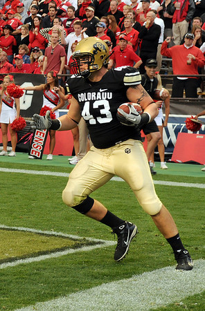 "University of Colorado tight end Matthew Bahr scores a touchdown in the first quarter of the football game against University of Georgia on Saturday, Oct. 2, at Folsom Field. For more photos go to  <a href=""http://www.dailycamera.com"">http://www.dailycamera.com</a><br /> Photo by Jeremy Papasso"